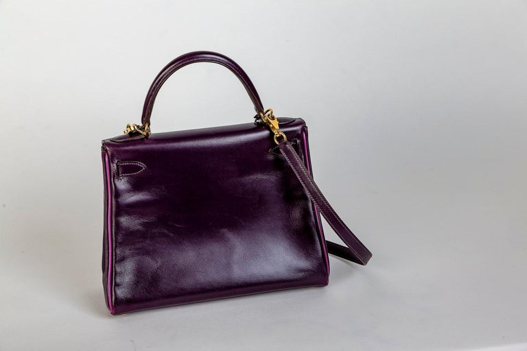 Kelly bag in a very rare purple-pink color with gold hardware. 4 side seams polished with pink leather pass and lined with pink leather inside. It is a SPECIAL EDITION! The bag comes with 90 cm long shoulder strap clochette and keys and dust bag .