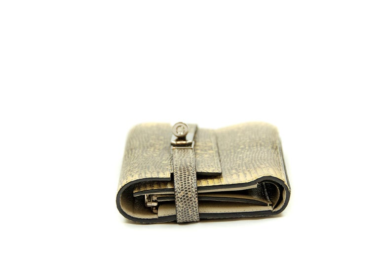Guaranteed authentic Hermes Kelly Bifold Ombre Salvator Lizard Medium Wallet. This iconic special order Hermes Wallet is timeless and chic. Fresh and crisp with palladium hardware.       Condition: New or Never Used     Made in France     Comes with