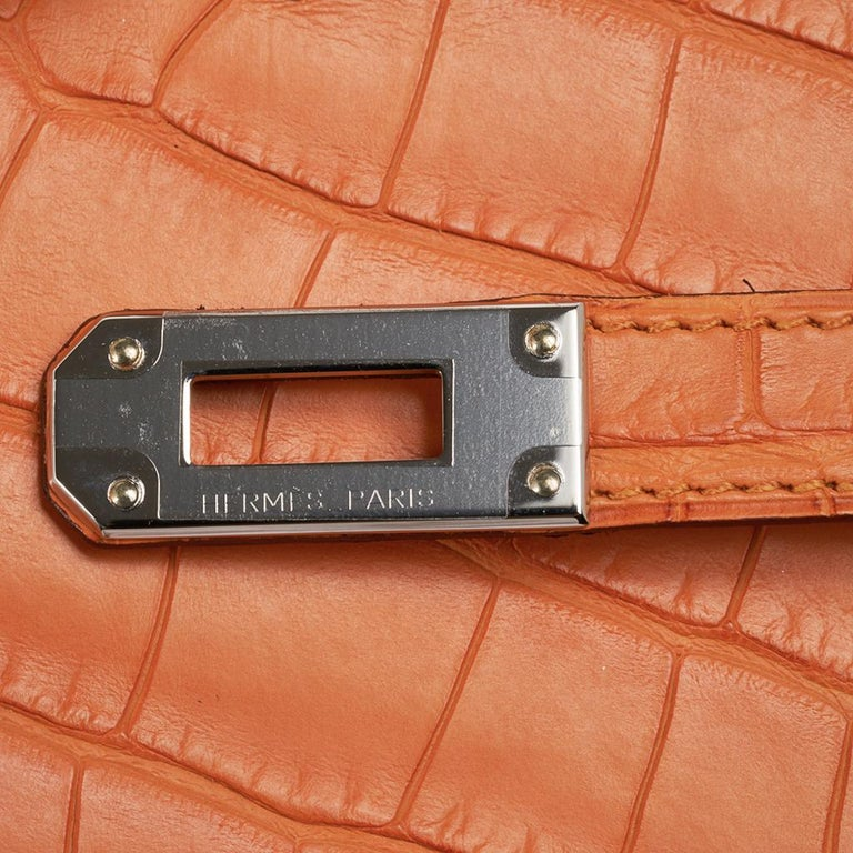 Hermes Kelly Classic Long (Longue) wallet featured in rare Abricot matte alligator.  Often carried as a clutch, this Kelly wallet beauty is a jewel in your hand. Kelly Cadena zipper pull.   Twelve (12) credit slots.  Two (2) bill pockets.   Zip