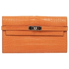 Hermes Kelly Classic Long (Longue) wallet featured in rare Abricot matte alligat