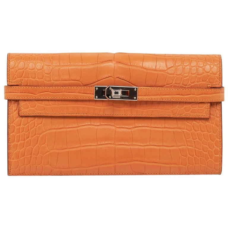 Hermes Kelly Classic Long (Longue) wallet featured in rare Abricot matte alligat For Sale