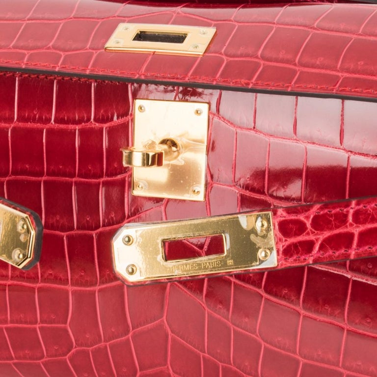 Guaranteed authentic timeless Hermes Kelly Cut bag features vivid Braise Niloticus Crocodile. This exquisite lipstick red Hermes clutch is perfect day to evening.  Lush with Gold hardware. Comes with sleeper and signature Hermes box with ribbon.