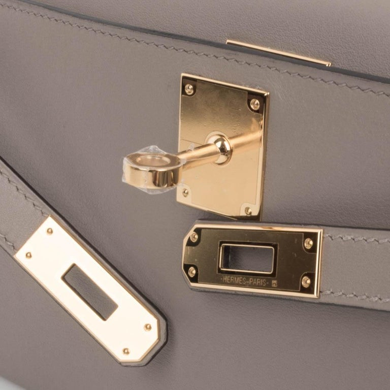 Guaranteed authentic Hermes Kelly Cut in the understated elegance of Gris Asphalte - the perfect gray hue. Rich gold hardware. Swift leather.  Comes with box, sleeper and signature Hermes box.   NEW or NEVER WORN.  final sale  BAG MEASURES: LENGTH