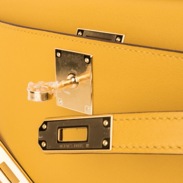 Guaranteed authentic timeless Hermes Kelly Cut bag featured in warm Jaune Ambre. This beautiful Hermes clutch is perfect day to evening for year round wear.  Swift leather.  Lush with Gold hardware.   NEW or NEVER WORN.    Comes with sleeper and
