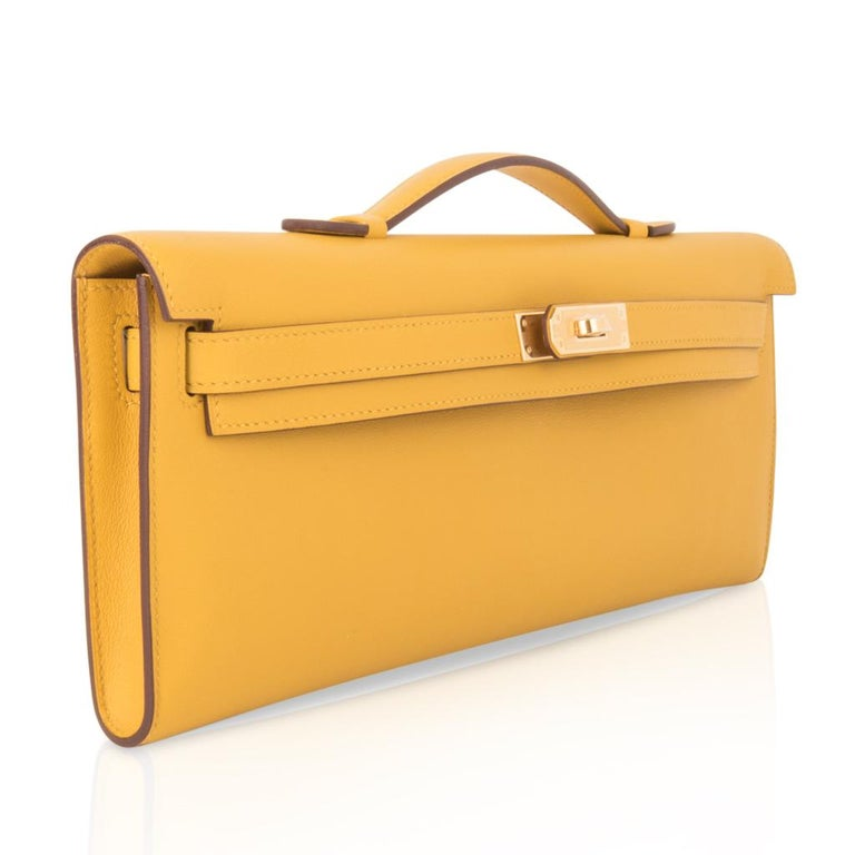 Hermes Kelly Cut Bag Jaune Ambre Clutch Swift Gold Hardware New In New Condition For Sale In Miami, FL
