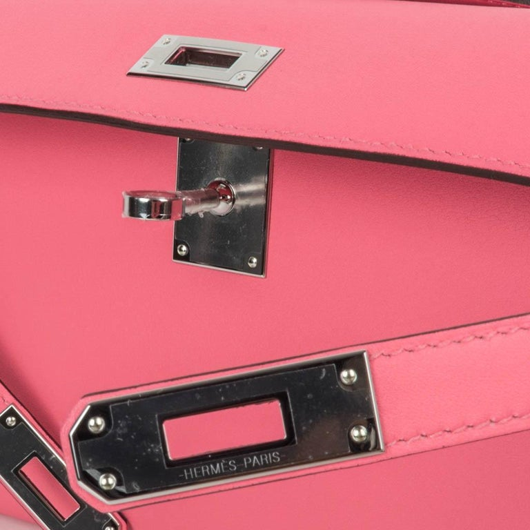 Guaranteed authentic timeless Hermes Kelly Cut bag featured in Rose Azalee. This beautiful pink Kelly Cut clutch is perfect day to evening.  Swift leather.  Fresh with palladium hardware.  NEW or NEVER WORN.    Comes with sleeper and signature