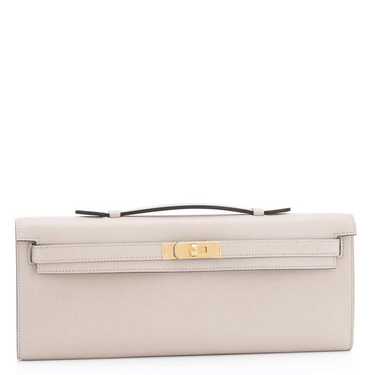 Guaranteed Authentic Hermes Kelly Cut Beton Cream Grey Clutch Swift Gold Hardware Y Stamp, 2020 Brand New in Box. Store fresh. Pristine condition (with plastic on hardware). Just purchased from Hermes store; bag bears new 2020 interior Y