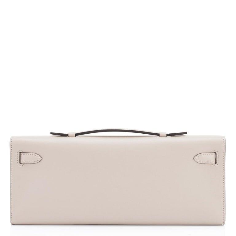 Women's or Men's Hermes Kelly Cut Beton Cream Grey Clutch Swift Gold Hardware Y Stamp, 2020 For Sale