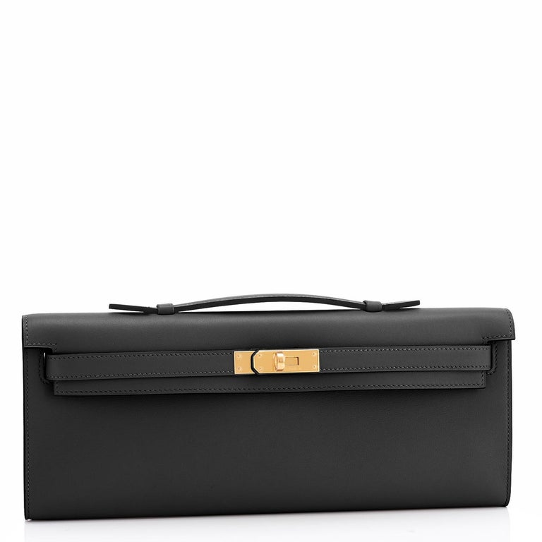 Hermes Kelly Cut Black Clutch Pochette Swift Gold Hardware D Stamp, 2019 Brand New in Box. Store fresh. Pristine condition (with plastic on hardware). Just purchased from Hermes store; bag bears new 2019 interior D stamp. Perfect gift! Comes with