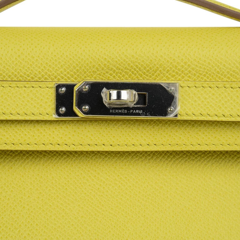 Mightychic offers a guaranteed authentic Hermes Kelly Cut bag feautred in Souffre. Souffre is a fresh yellow pop of neutral colour and rare to find in Epsom.  Accentuated with palladium hardware.  This treasure is easily carried day or night, casual