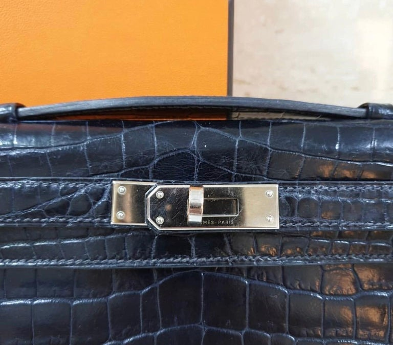 Beautiful pouch Kelly cut blue marine crocodile porosus smooth new to seize because very difficult to find.  With people waiting years to get their hands on this bag, it holds a lot of value and is a true collector's item. Watch as people turn to