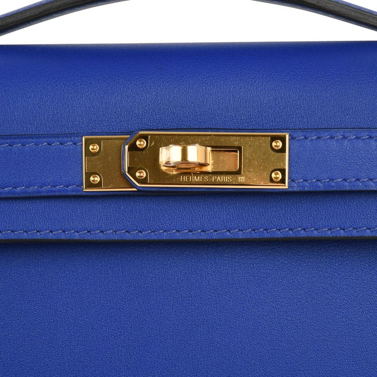 Guaranteed authentic timeless Hermes Kelly Cut feature in rich jewel toned Electric Blue. This brilliant vivid blue is perfect day to evening. Swift leather.  Lush with Gold hardware. Comes with box, sleeper and signature Hermes box.   NEW or NEVER