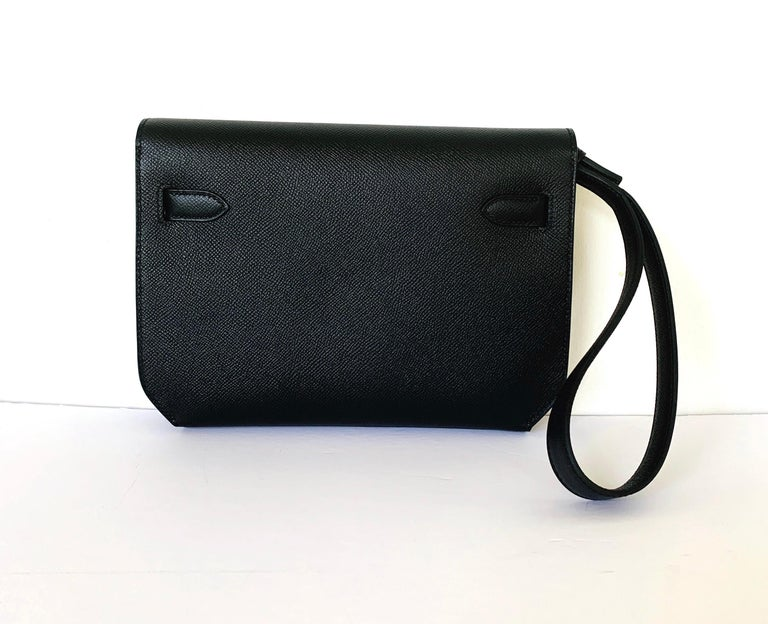 Hermes Kelly Depeche 25  Condition: Store Fresh Color: Black Material: Epsom Leather Hardware: Palladium Collection: D Dimensions: L 25.2 x H 19.5 x D 4 cm It has been over a decade since Hermes has introduced a new Kelly clutch; handheld versions