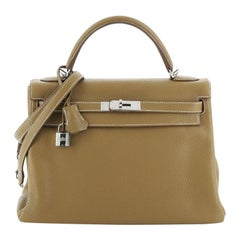 Hermes Kelly Handbag Curry Clemence with Palladium Hardware 32