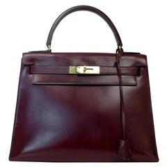 HERMÈS Kelly Handbag in Burgundy Leather