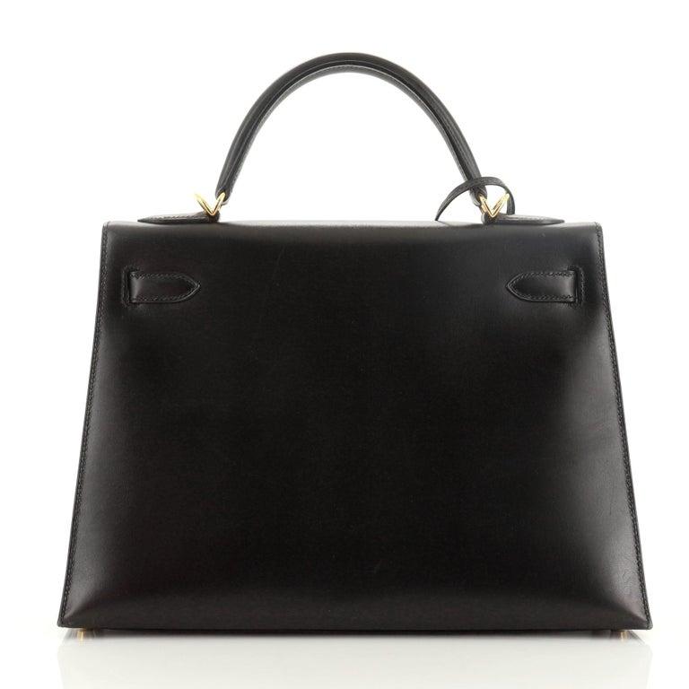 Women's or Men's Hermes Kelly Handbag Noir Box Calf with Gold Hardware 32 For Sale