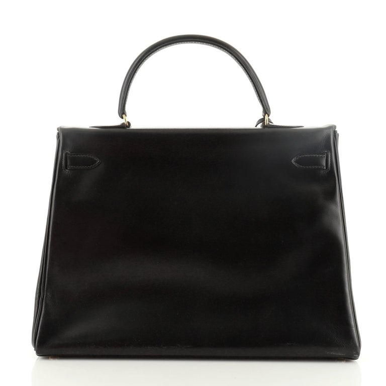 Hermes Kelly Handbag Noir Box Calf with Gold Hardware 35 In Good Condition For Sale In New York, NY