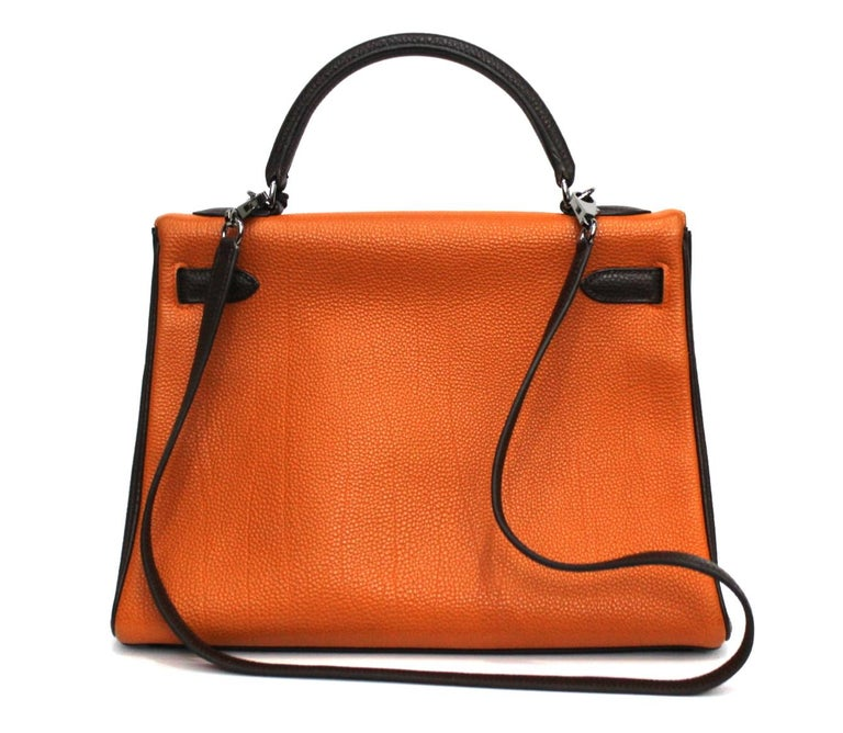 This fantastic Hermes Kelly Tricolor Togo in size 32 is constructed with scratch-resistant Togo leather in striking blood orange front, tangerine back, and chocolate brown sides and trimming. Accented with polished Palladium hardware and silver
