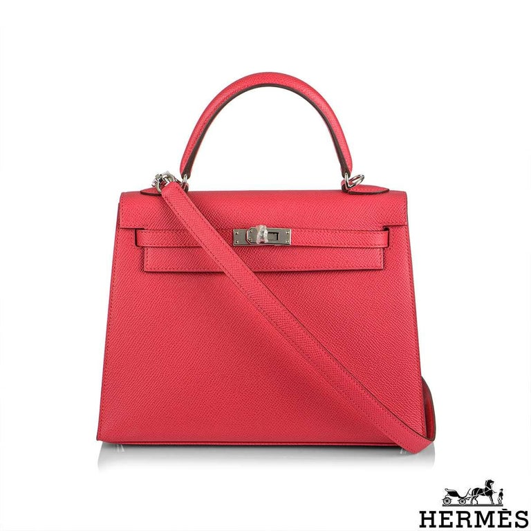 An exquisite Hermès Kelly II Sellier 25cm Epsom Rose Extreme handbag. The exterior of this Kelly features a sellier style in rose extreme epsom leather. The vivid rose epsom leather is complimented with palladium hardware and tonal stitchings. It