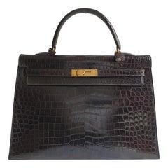 Hermès, Kelly in brown Porosus Crocodile