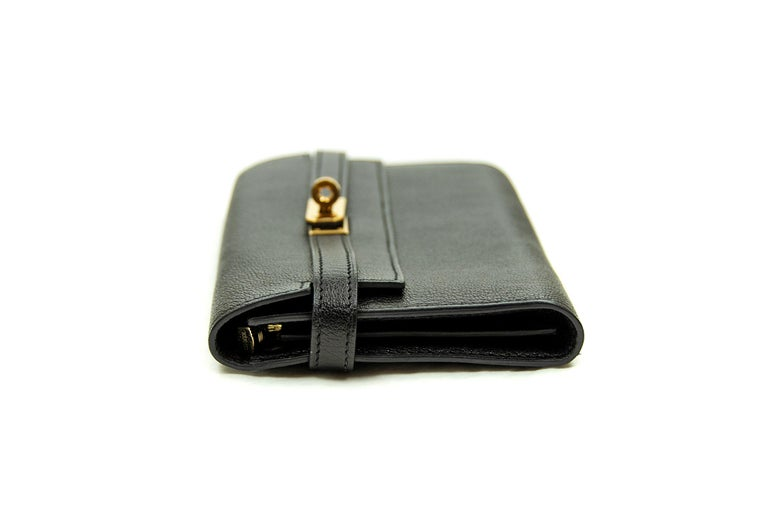 Guaranteed authentic Hermes Kelly Long Black Wallet. This iconic special order Hermes wallet is timeless and chic. Fresh and crisp with gold hardware.       Condition: New or Never Used     Made in France     Bag Measures: 19.5cm (7.7