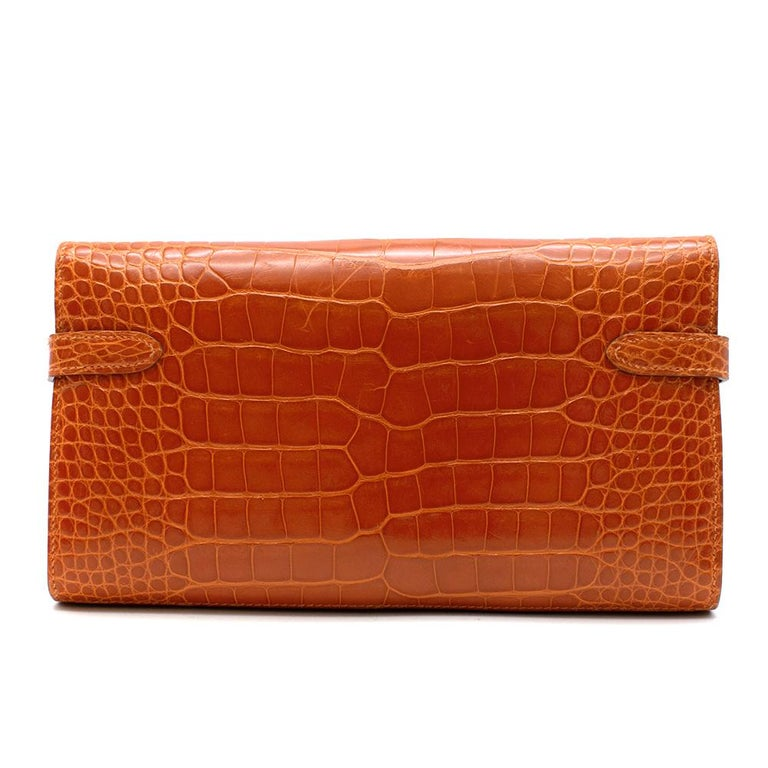 Hermès Kelly Long Wallet in Feu Lisse Alligator Mississippiensis with Palladium Hardware.  2014  Includes Dust Bag.  Size: Long  11.5 x 19.7 cm