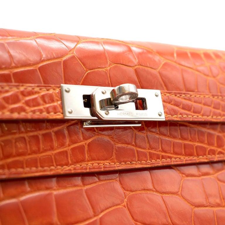 Hermès Kelly Long Wallet in Feu Lisse Alligator Mississippiensis PHW For Sale 1