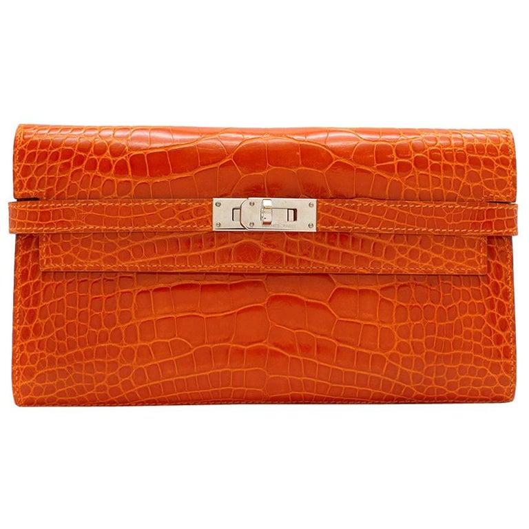Hermès Kelly Long Wallet in Feu Lisse Alligator Mississippiensis PHW For Sale