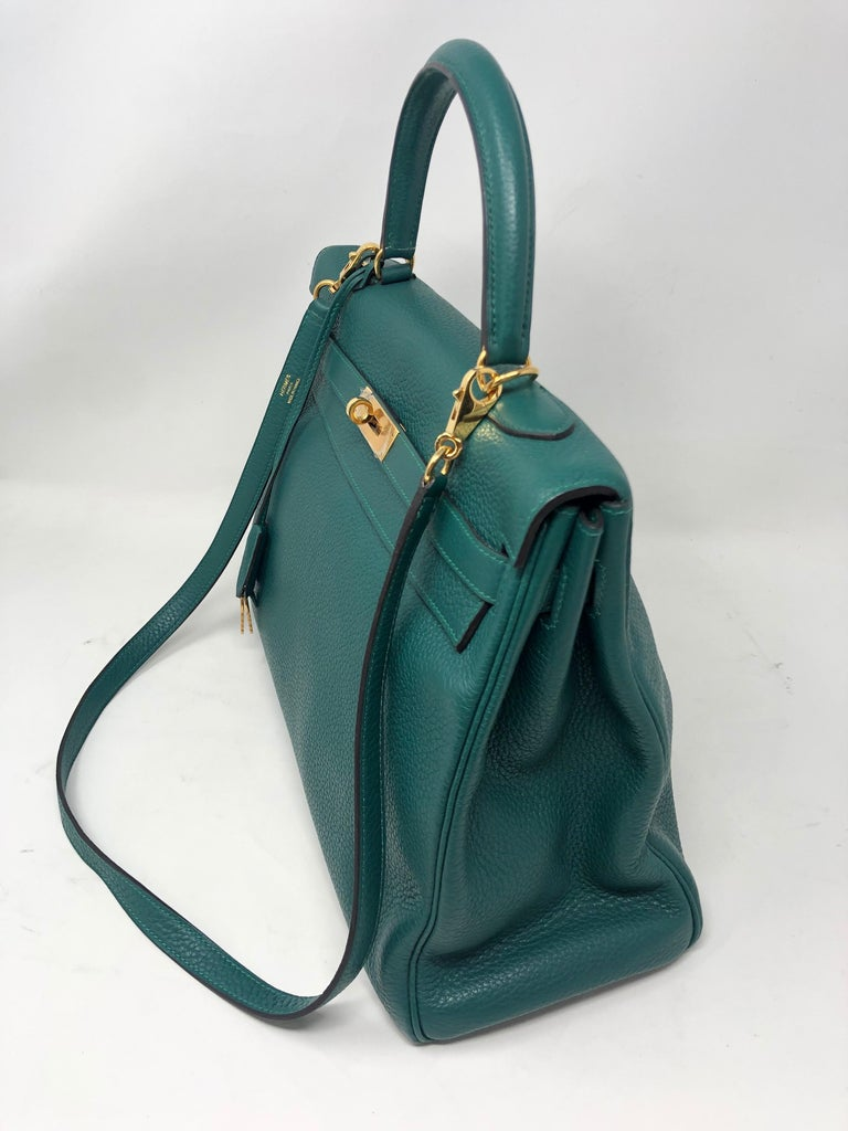 Hermes malachite green Kelly 35 bag with gold hardware. Excellent condition. Plastic still on hardware. Togo leather. B square. Includes lock, keys, clochette and Hermes dust cover. Guaranteed authentic.