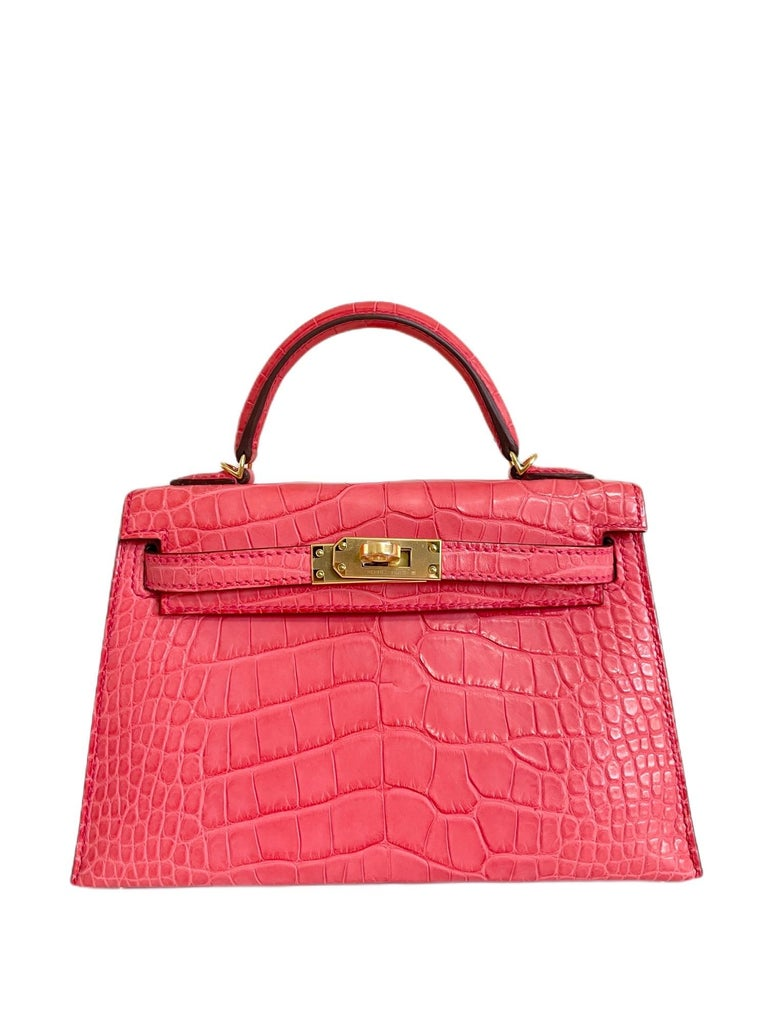 New Rare Hermes Kelly Mini 20 Alligator Bougainvillea Pink Gold Hardware. Full set with copy of receipt and cites. Y Stamp 2020.   Shop with Confidence from Lux Addicts. Authenticity Guaranteed!