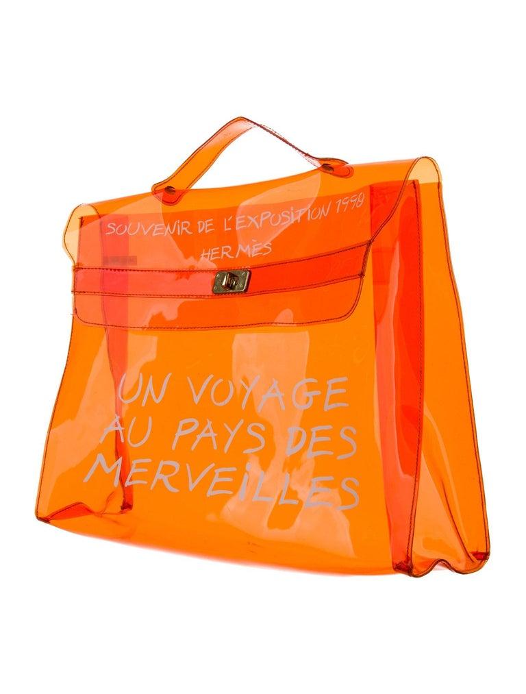 Hermes Kelly Orange Carryall Travel Top Handle Satchel Tote Bag  Vinyl Gold tone hardware Turnlock closure Handle drop 1.5