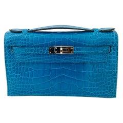 Hermès Kelly petrol blue silver hardware alligator clutch