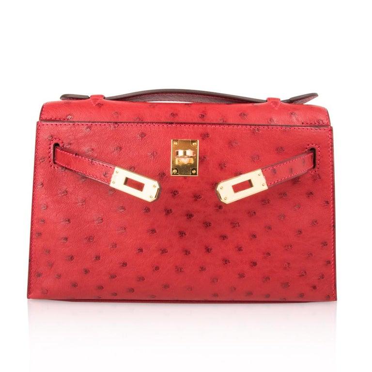 Hermes Kelly Pochette Bag Rouge Vif Red Ostrich Clutch Gold Hardware For Sale 2