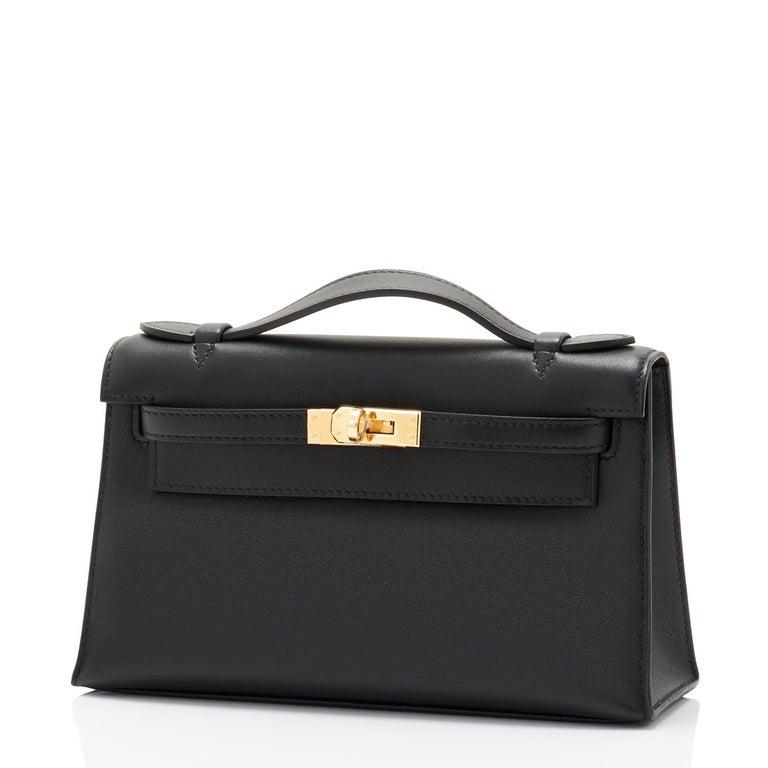 Women's or Men's Hermes Kelly Pochette Black Gold Hardware Clutch Cut Bag Swift D Stamp, 2019 For Sale