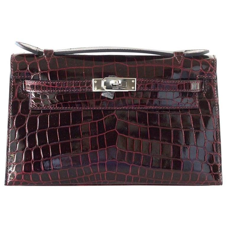 Hermes Kelly  Pochette Clutch Bag Rare Bordeaux Crocodile Palladium For Sale