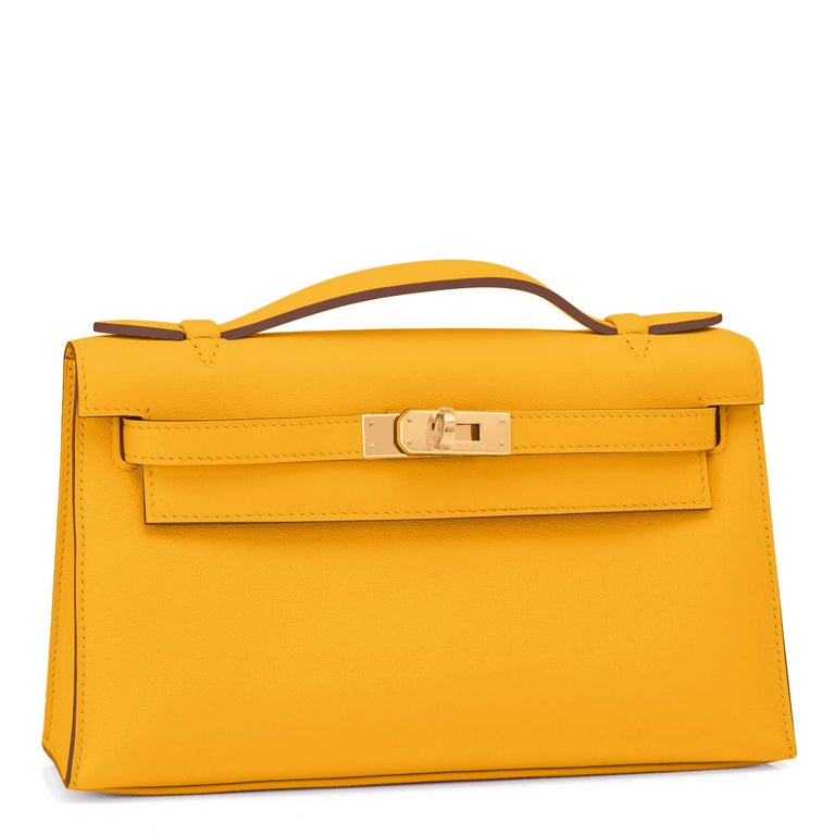 Hermes Kelly Pochette Jaune Amber Gold Hardware Clutch Cut Bag Y Stamp, 2020 Jaune Amber is a gorgeous rich yellow that is so coveted with gold hardware in this rare Kelly Pochette. This superb color is perfect for spring summer 2021 in our joyous