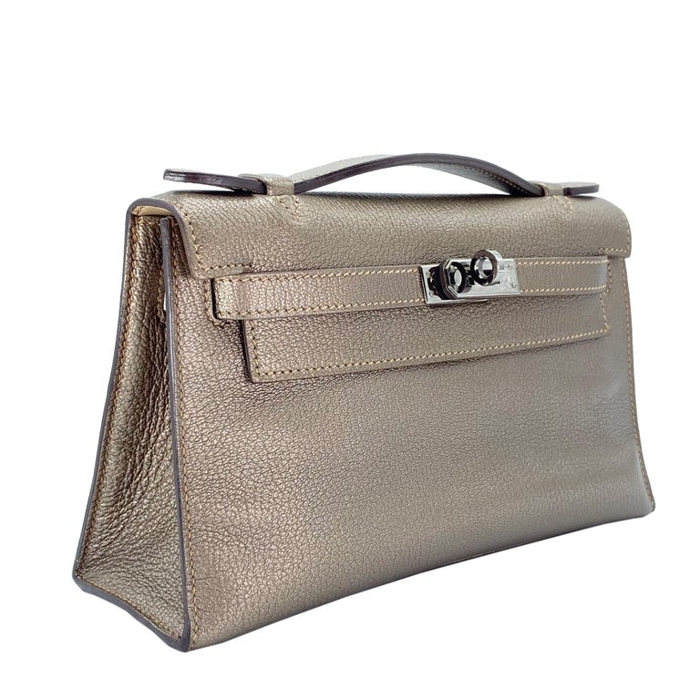 Brand: Hermès  Style: Kelly Pochette  Color: Bronze Metallic Leather: Chrevre Hardware: Ruthenium Stamp: 2005 I  Condition: Vintage excellent: This item is vintage and shows natural signs of aging. This item will also have some wear to the leather