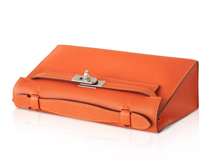 Guaranteed authentic Hermes Orange Feu Kelly  Pochette. Fresh in epsom leather and palladium hardware. Signature stamp on interior. Small interior compartment. Comes with sleeper and signature HERMES box.  NEW or NEVER WORN.  final sale  BAG