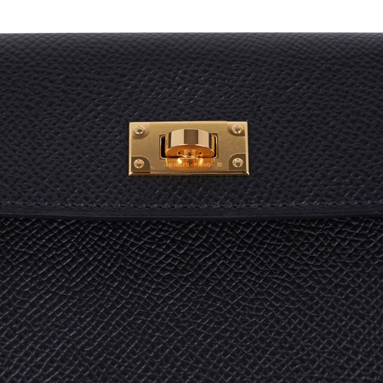 Guaranteed authentic Hermes Pocket Compact Wallet featured in Noir Espom calfskin. Striking with Gold Hardware, this compact wallet has a central pocket and rear Kelly Cadena zipped change purse. NEW or NEVER WORN final sale  WALLET MEASURES: LENGTH