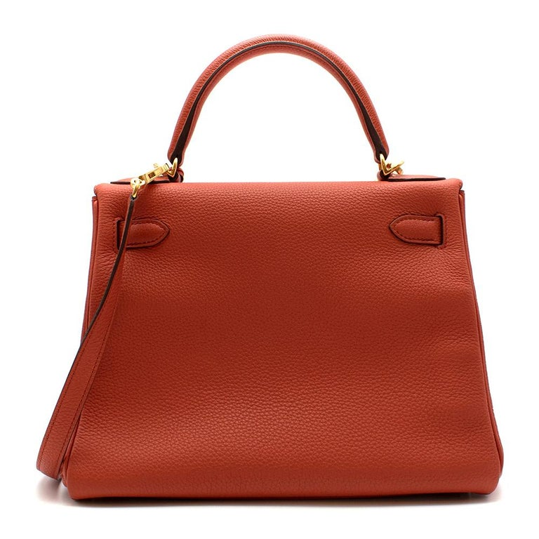 Hermès Kelly Retourné 28 in Rosy Togo Leather with Gold Hardware.  2016  Includes Clochette, Detachable Strap, Dust Bag, and Lock and Keys Size: 28   28 x 22 x 10 cm