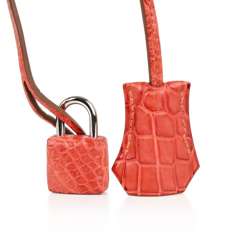 Guaranteed authentic Hermes 35 Retourne Kelly bag featured in timeless Matte Alligator Sanguine.    Fresh palladium hardware.    NEW or NEVER WORN. Comes with shoulder strap, lock, keys, sleepers, raincoat and signature Hermes box. final sale  BAG