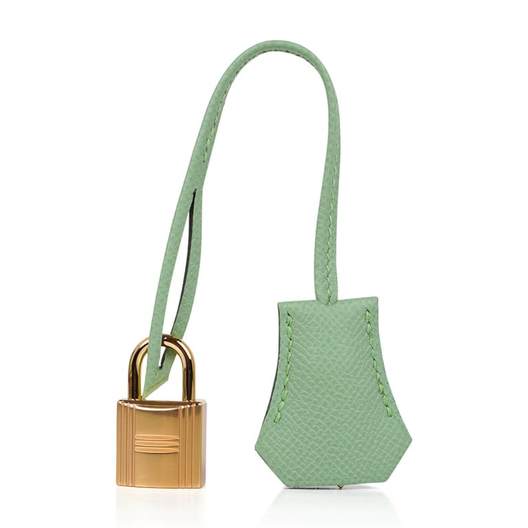 Guaranteed authentic Hermes Kelly Sellier 25 bag featured in fresh Vert Criquet.  Stunning Hermes light green that is absolutely neutral.  Luxurious with gold hardware.  Comes with signature Hermes box, raincoat, shoulder strap, sleepers, lock, keys