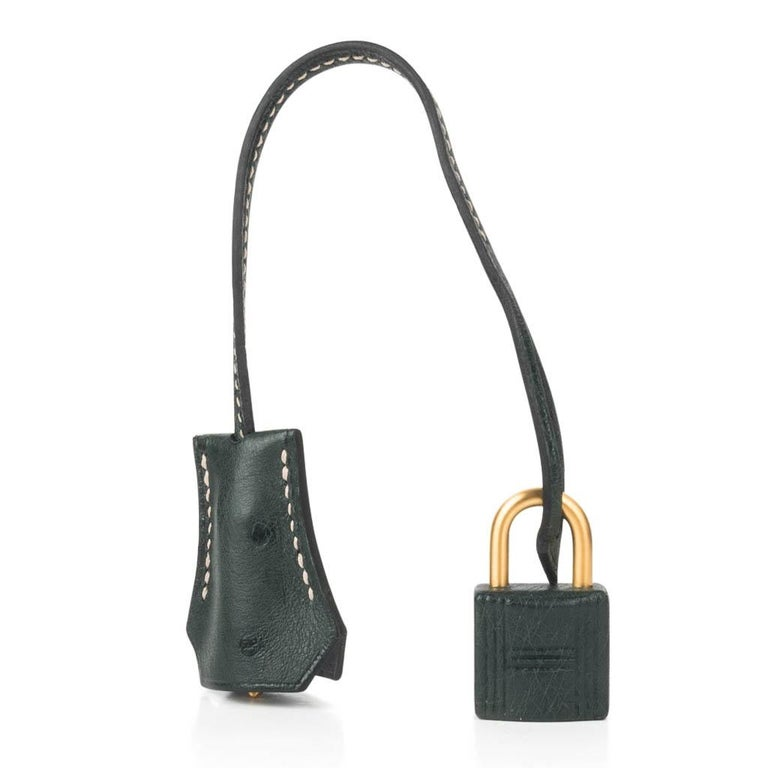 Guaranteed authentic Hermes Kelly 28 Sellier HSS Gris Agate and Vert Titien featured in ostrich.  This iconic special order Hermes bag is timeless and chic. Exquisite with brushed Gold Hardware.    This rich, neutral palate is a perfect year round