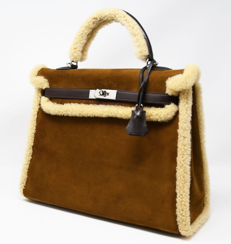 Hermes 35cm Kelly Sellier Teddy Shearling bag with ebene barenia, sheepskin woola & chevre leather. This iconic special order Hermes Kelly Sellier bag is timeless and chic. Fresh and crisp with palladium hardware.      Condition: Excellent, Pre