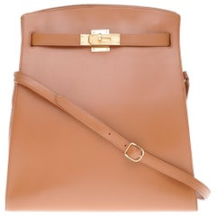 Hermès Kelly sport shoulder bag in courchevel gold leather with gold hardware