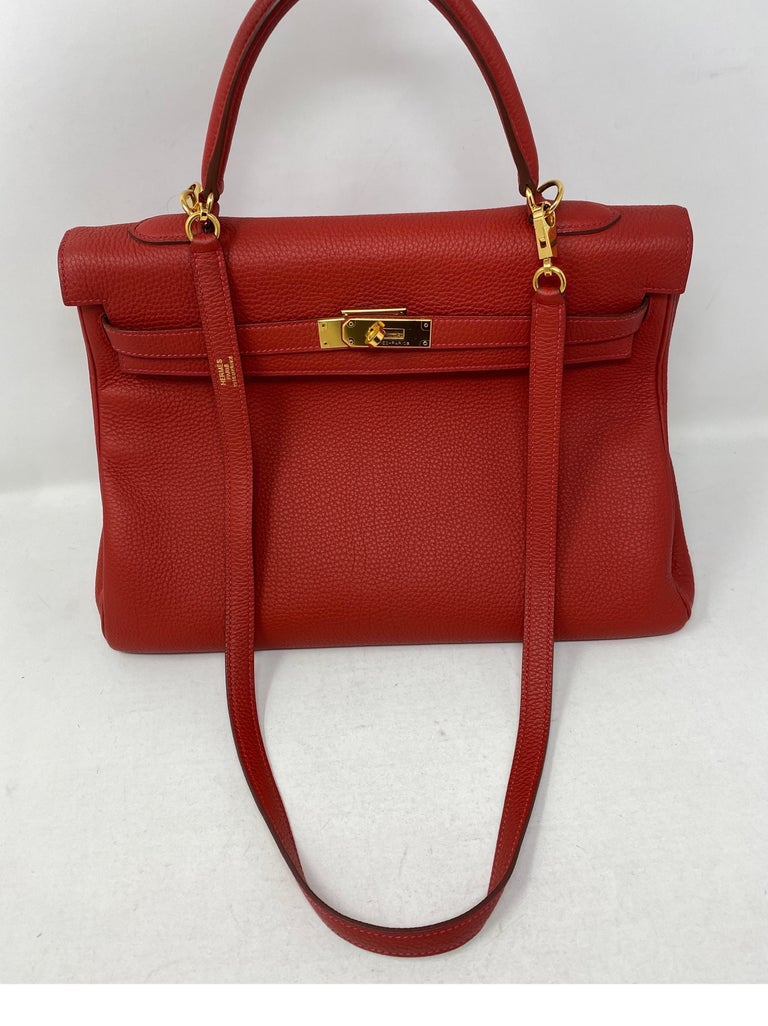 Hermes Vermillion Red Kelly 35 Bag. Beautiful red with orange undertones color with gold hardware. Togo leather. Good condition. Comes with original receipt. Guaranteed authentic.