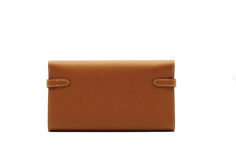 Brand: Hermès  Style: Kelly Wallet Size: Long Color: Gold Leather: Epsom Hardware: Palladium  Stamp: 2018 C  Condition: Pristine, never carried: The item has never been carried and is in pristine condition complete with all accessories.  Accompanied
