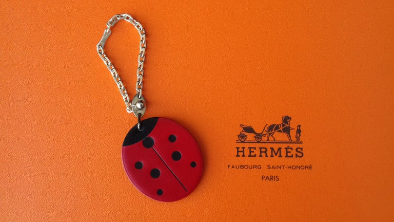 Super Cute Authentic Hermès Key Holder  Can be used as Bag Charm for your Kelly, Birkin or other Hermès Bag  Pattern: Ladybug  Made of Smooth Leather and Sterling Silver  Colorway: Red, Black