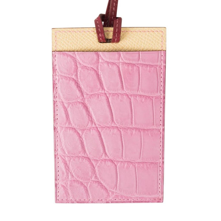 Guaranteed authentic Hermes Petite h Lanyard card holder. 5P Pink Porosus Crocodile and Jaune Epsom leather with an orange interior. Cardholder has a slot on each side and a thin rouge leather strap. Comes with signature Hermes box and Cites. New or