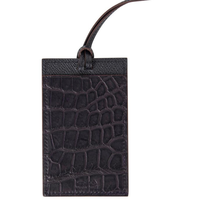 Guaranteed authentic Hermes Petite h Lanyard card holder. Prunoir Matte Crocodile and Gris in Epsom leather. Card holder has a slot on each side and a thin Black Epsom leather strap. Comes with box and Cites. New or Never Worn. final